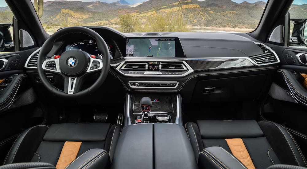 A trademark of the BMW M Series is the luxurious interior, shown here in a 2020 BMW X5 M parked in front of hills outside Cincinnati, OH.