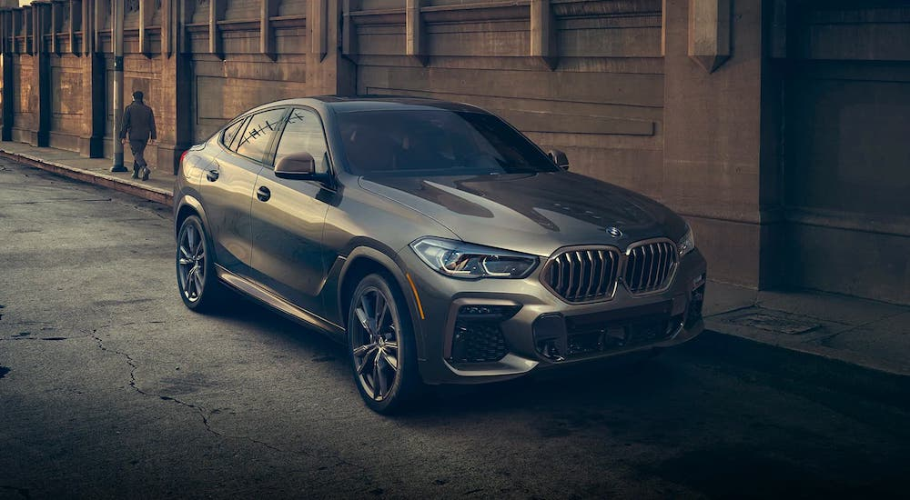 A gray 2021 BMW X6 is parked in an alley after getting a BME lease deal.